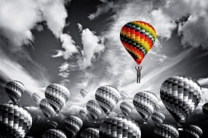 Businessman leader rising in a hot air balloon - Leadership conc